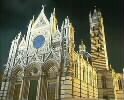 Brightly lit cathedral at night